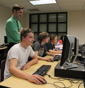 Woodland Regional High School English teacher Paul Geary, who is the administrator for the school's alternative education program, looks over students in the program as the work June 18. –ELIO GUGLIOTTI