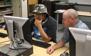 Woodland Regional High School student E.J. Valles, left, works with history teacher Robert Murdy June 18 during the alternative education program. Valles will graduate next week. –ELIO GUGLIOTTI