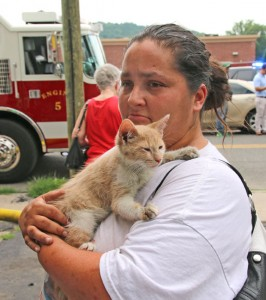 Pamela Ready holds one of the cats rescued from a fire at 19 Diamond St. in Naugatuck Tuesday. Ready lives in a neighboring building. The fire, which started in the first floor apartment, damaged both the first and second floor apartments. All the people inside escaped without injury, but five cats perished in the fire. –LUKE MARSHALL