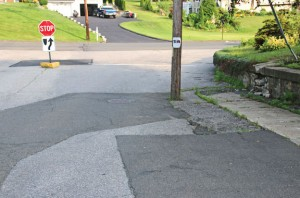 A telephone pole is in Highland Avenue in Beacon Falls. Major reconstruction of the road, which is off of Burton Road, is scheduled to begin this month. –FILE PHOTO