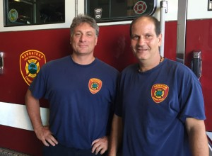 Naugatuck firefighter Leonard Patterson, left, and firefighter/assistant mechanic James Ricc. - REPUBLICAN-AMERICAN