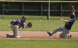 Naugatuck's Ryan Russell (24) safely steals second base in front of the tag by Tri-Town's Devin Murphy (2) during the Stan Musial championship game at Fuessenich Park in Torrington on Sunday. Naugatuck defeated Tri-Town, 6-1. –REPUBLICAN-AMERICAN