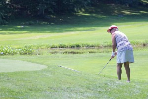 Nancy Clark pitches on to the first green Sunday at Hop Brook Golf Course in Naugatuck during the Ladies Championship. Clark defeated last year's champ, Stephanie Slekis, four and three to take the title. –ELIO GUGLIOTTI