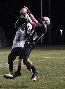 Woodland's Quincy Koch (16) breaks up a pass intended for Wilby's Christopher (3) Albert Oct. 30 in Beacon Falls. Woodland won, 39-6. –ELIO GUGLIOTTI