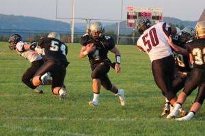 Woodland senior running back Sean McAllen (4) holds school records in ten separate categories and is in the top ten in nine more. –ELIO GUGLIOTTI