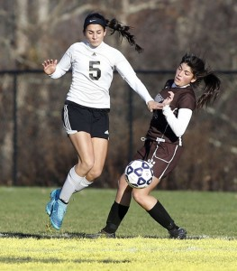 Woodland's Julia Casimiro, left, and Stonington's Jessica Connor go in for the ball during the Class M quarterfinal in Beacon Falls Nov. 13. Woodland won, 4-1. -REPUBLICAN-AMERICAN