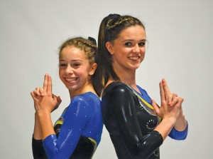 Twin sisters and Woodland freshmen Kristina, left, and Stephanie Poynton are representing Woodland as a team of two for gymnastics. –CONTRIBUTED