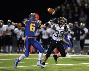 Woodland's Issac Negron (33) stretches out for a pass as Seymour's Bobby Melms (6) defends Nov. 25 in Seymour. Seymour won the game, 53-7. -REPUBLICAN-AMERICAN