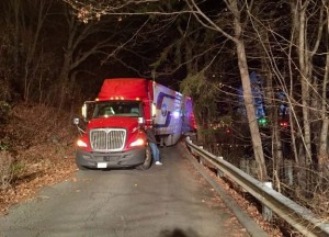 A tractor-trailer carrying 43,343 pounds of yogurt was stuck Monday in Naugatuck after failing to negotiate a tight turn. -REPUBLICAN-AMERICAN