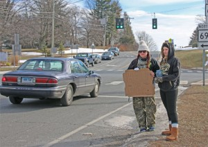 Prospect Congregational Church Youth Leader Kayla Reilly, left, and youth group member Brianna Hudson collect money to help the homeless at the intersection of routes 68 and 69 in Prospect Jan. 30 during the group's annual Homeless Awareness Sleepout. –LUKE MARSHALL