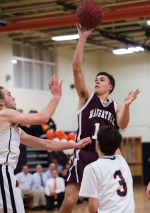 Naugatuck's Michael Plasky goes up for a shot Feb. 19 in front of Watertown's Nick Mondak and Mike Vailonis at Watertown High. Watertown won the game, 49-46. -REPUBLICAN-AMERICAN