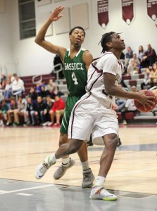Naugatuck's Fejiro Onakpoma (35) goes strong to the basket past Bassick's Jordan Gallimore (4) Jan. 28 in Naugatuck. Bassick won the game, 81-63. –ELIO GUGLIOTTI