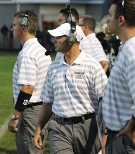 Woodland head football coach Chris Anderson, center, resigned earlier this month. –FILE PHOTO