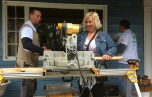 Homeowner Tammy Andrews assists volunteers in repairing her home Saturday in Prospect. –REPUBLICAN-AMERICAN