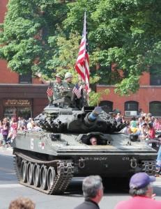 A M-551 Sheridan tank that saw combat action during the Vietnam War makes its way up Church Street during Naugatuck's Memorial Day parade last year. –FILE PHOTO