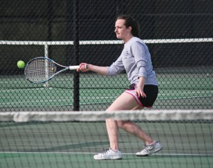 Woodland's Paige Gainey returns a shot during a doubles match with her partner Katie Rioux versus Seymour's Emily Curina and Madison Baur Monday in Beacon Falls. Woodland won the match, 4-3. –ELIO GUGLIOTTI