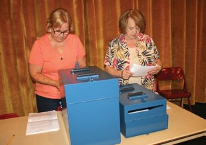 Beacon Falls Deputy Registrar Marion Lennon Zollo, right, and Julian Groth prepare to count ballots at a town meeting to vote on bonding $1.2 million for capital items June 8 at Woodland Regional High School. –LUKE MARSHALL