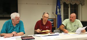 From left, Prospect Town Council Chairman Tom Galvin, council members Stan Pilat and Jeff Slapikas discuss proposed revisions to the town Charter Tuesday at the Prospect Library. –LUKE MARSHALL
