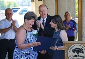 Naugatuck Portuguese Mayor of the Day Flora Fidalgo Keefe, left, receives a proclamation from state Rep. Rosa Rebimbas, R-Naugatuck, as state Rep. David Labriola, R-Oxford, looks on during a ceremony Sept. 2 at Naugatuck Town Hall. –LUKE MARSHALL