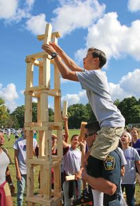 City Hill Middle School seventh-grader Cameron Jacobs works on constructing the tallest block building possible with the help of Naugatuck police Officer Aaron Borys during a field day Sept. 16 at the school in Naugatuck. The event, which included a variety of games that require teamwork, was put on as part of the school's Wingman Program. –LUKE MARSHALL