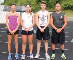 Woodland cross country captains, from left, junior Emilie Noreika, and seniors Meredith Dyckman, Matthew Giaquinto and Colin Kennelly will lead the Hawks this season. –ELIO GUGLIOTTI