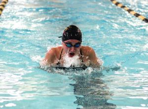 Woodland's Dia Gawronski does the breaststroke during the 200 medley relay against Jonathan Law Sept. 14 in Beacon Falls. Woodland won the meet, 96-81. –ELIO GUGLIOTTI