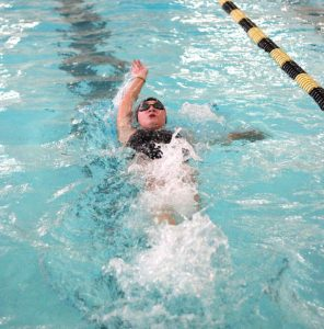 Woodland's Jordan Williams does the backstroke during the 200 medley relay against Jonathan Law Sept. 14 in Beacon Falls. Woodland won the meet, 96-81. –ELIO GUGLIOTTI