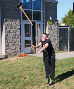 Woodland Regional High School freshman Sean O'Connell throws an axe during a Woodland timber team practice Oct. 11 at the school in Beacon Falls. The timber team started this fall. –LUKE MARSHALL