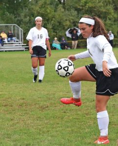 Woodland's Haley Andrews (8) gets control of the ball versus Jonathan Law. Woodland won the game, 4-0. –LUKE MARSHALL