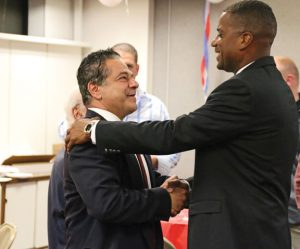 State Senator-elect George Logan, right, a Republican, shakes hands with Ansonia Mayor David Cassetti Tuesday night at his headquarters in Ansonia. Logan defeated state Sen. Joseph Crisco, a Democrat, in the 17th District. –LUKE MARSHALL